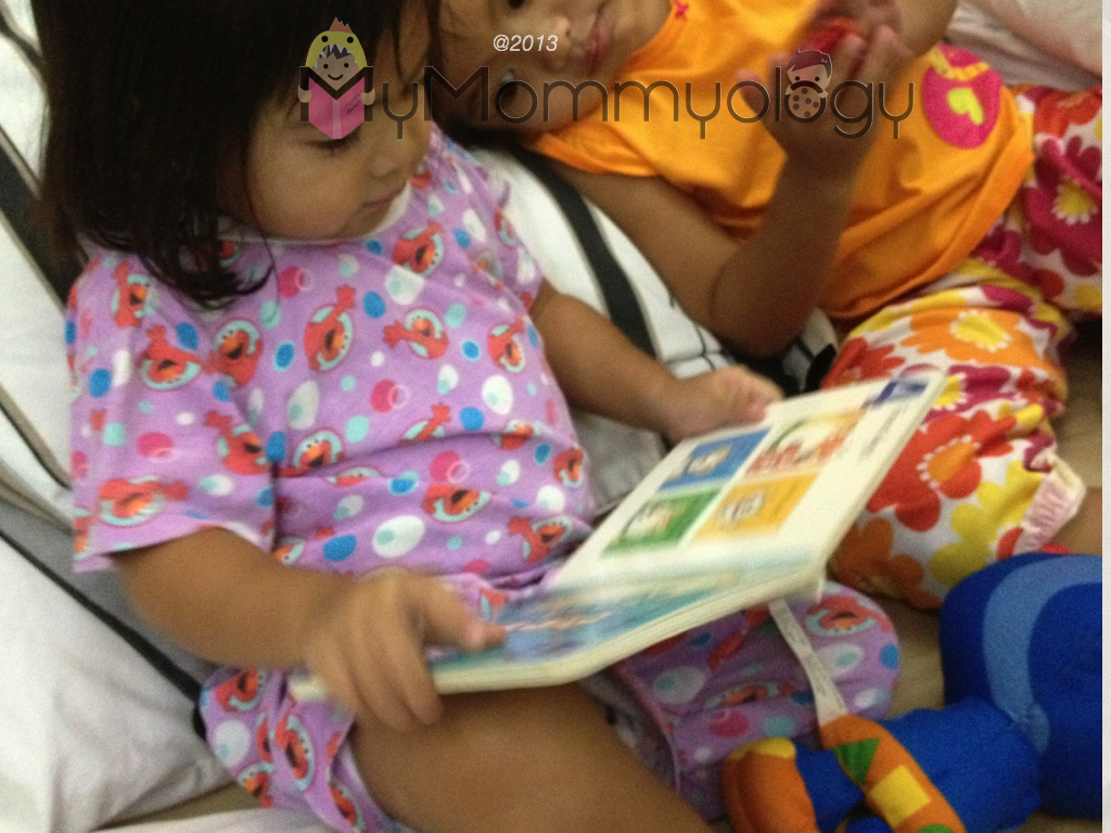 Jamie returns the favor and reads to her Ate. :)