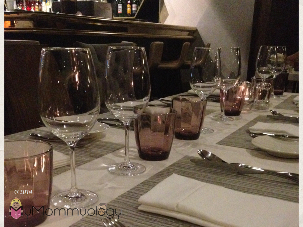 The table setting.  Ooh, wine glasses!  It's a sign. ;)